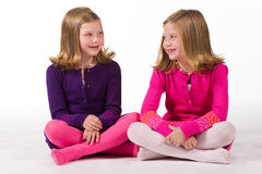 Beautiful twin girls playing Stock Photos