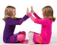 Beautiful twin girls playing Royalty Free Stock Image