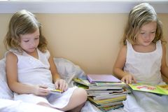 Beautiful twin little girls doing homework Stock Image