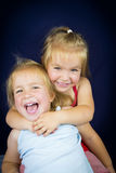 Beautiful twin little girls Stock Images