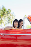 Beautiful twin sisters in cabriolet car Stock Photo