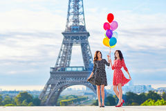 Beautiful twin sisters with colorful balloons Royalty Free Stock Photography