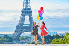 Beautiful twin sisters with colorful balloons Royalty Free Stock Photo