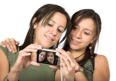 Beautiful twins with digital camera Stock Photography