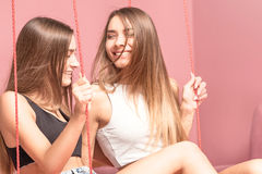 Beautiful twins sisters smiling together, happy moments. Stock Photos