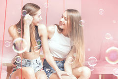 Beautiful twins sisters smiling together, happy moments. Stock Photography