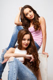 Beautiful twins young women in casual clothes over white background. Beauty fashion portrait Royalty Free Stock Image