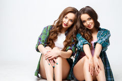 Beautiful twins young women in casual clothes over white background. Beauty fashion portrait Royalty Free Stock Photo