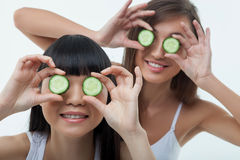 Beautiful two girls are caring of skin Stock Photos