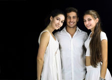 Beautiful two girls and one boy dressed in white smiling Royalty Free Stock Photography