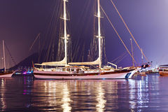 Beautiful two-masted yacht moored in the harbor in the evening Stock Photos