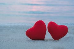 Two red heart on the beach royalty free stock photography