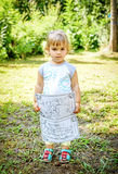 Beautiful Two year old baby girl holding drawing coloring book in her Royalty Free Stock Photo