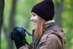 Beautiful twoman tourist travel photographer photographing forest at autumn day. Odessa Royalty Free Stock Image