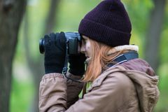Beautiful twoman tourist travel photographer photographing forest at autumn day. Odessa Royalty Free Stock Photography