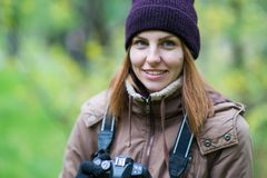 Beautiful twoman tourist travel photographer photographing forest at autumn day. Odessa Stock Photography