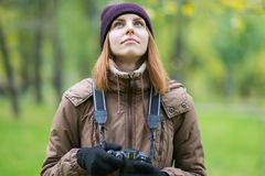 Beautiful twoman tourist travel photographer photographing forest at autumn day. Odessa Stock Images
