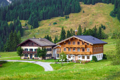 Beautiful typical mountain guests houses on austrian alps Royalty Free Stock Image