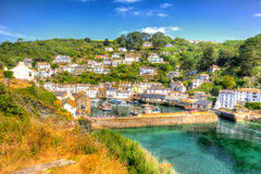 Beautiful UK Harbour Polperro Cornwall England With Clear Blue And Turquoise Sea In Vivid Colour HDR Like Painting Stock Photography