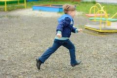 Amazing Ukrainian boy running around the playground stock images