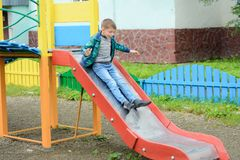 Funny children play on a children`s playground stock photos