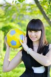 Beautiful Ukrainian girl with a ball Royalty Free Stock Image