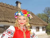 Beautiful Ukrainian girl in national clothes. Near the rural house Royalty Free Stock Images