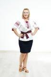 Beautiful Ukrainian girl in national costume. Beautiful Ukrainian plump woman in national costume. Attractive Ukrainian woman wearing in traditional Ukrainian Royalty Free Stock Images