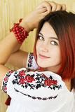 Beautiful Ukrainian girl in traditional embroidered shirt and green eyes Stock Image
