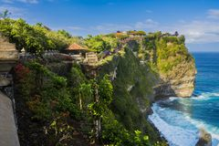Beautiful Uluwatu Temple perched on top of a cliff in Bali, Indo Stock Images
