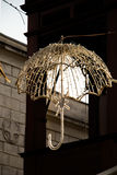Beautiful umbrella of golden color hanging in the street for dec Stock Photo