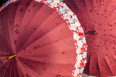 Beautiful umbrella that has flower graphic painted on. Sell at a souvenir shop in Yufuin city, Japan stock photo