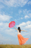 Beautiful umbrella woman exercise on blue sky Stock Images