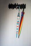 Beautiful umbrellas hang on wall Royalty Free Stock Photography