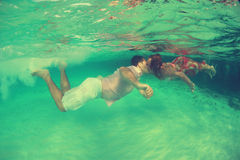 Beautiful underwater man and woman Royalty Free Stock Photos