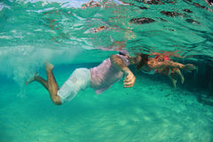 Beautiful underwater man and woman Stock Photography