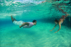 Beautiful underwater man and woman Stock Photos
