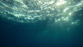 Beautiful underwater sea view with natural light rays in slow motion. Beautiful underwater sea scene view with natural light rays in slow motion, shining through stock footage