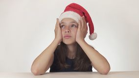 Beautiful unhappy teenage girl sad about the gift that did not get on white background Stock Image