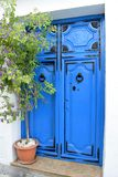 Beautiful and unique blue door and plant in Frigiliana - Spanish white village Andalusia Royalty Free Stock Image