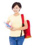 Beautiful university student girl standing and holding book Stock Images