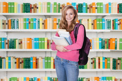 Beautiful University Student Standing In Library Royalty Free Stock Images