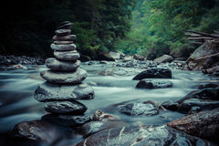 Beautiful unspoiled nature. Stones in an haze over the river stock photo