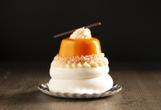 Beautiful unusual cake on a black background, close-up. stock images