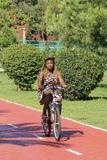 A girl goes for a drive on avenues on a bicycle royalty free stock photography