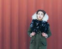 Beautiful unusual girl in green jacket Stock Photography