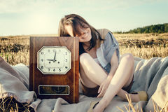 Beautiful unusual girl illustrates conceptual idea with watch Royalty Free Stock Images