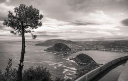 Beautiful upper aerial view on san sebastian coastline from mountain monte igueldo in  sunset sky in black and white sepia. Basque country, spain Royalty Free Stock Photography