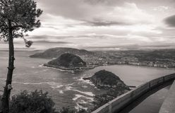 Beautiful upper aerial view on san sebastian coastline from mountain monte igueldo in  sunset sky in black and white sepia. Basque country, spain Royalty Free Stock Images