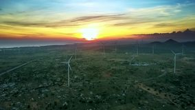 Wind Turbines and Sunset in Background Upper View. Beautiful upper view valley with rotating wind turbines and amazing bright sunset in background stock video
